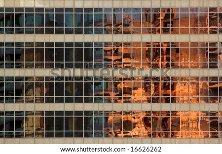 glass wall of a high-rise building in downtown Toronto