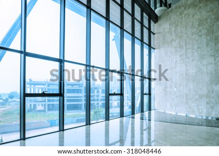 glass wall of interior space in a exhibition hall - stock photo