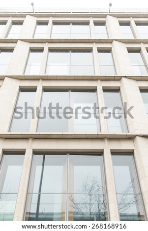 glass wall of office building with reflect - stock photo