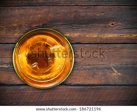 glass whiskey vintage wooden background.