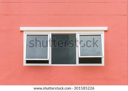 Glass window on the orange wall - stock photo