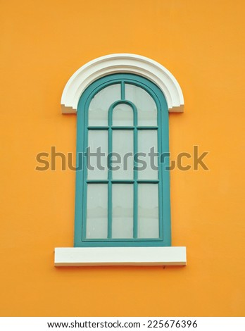 Glass window on yellow wall.