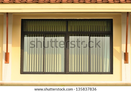 Glass window with green blinds - stock photo
