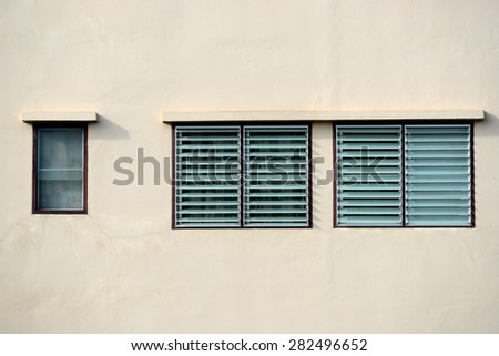 Glass windows and wall of building