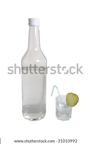 Glass wine-glass with vodka and the ringlet of a cucumber dressed on it on the isolated white background
