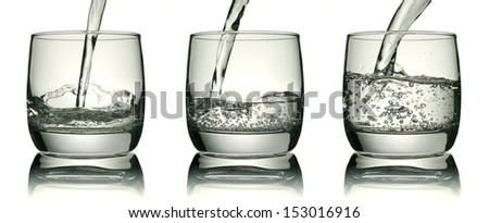 Glass with a water jet, clipping path's included - stock photo