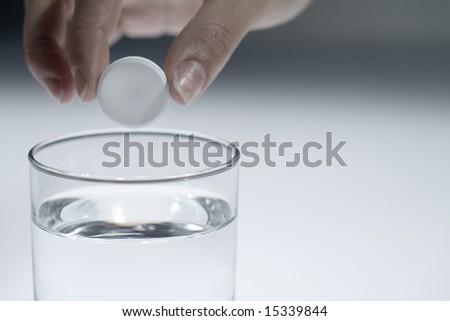 glass with aspirin - stock photo