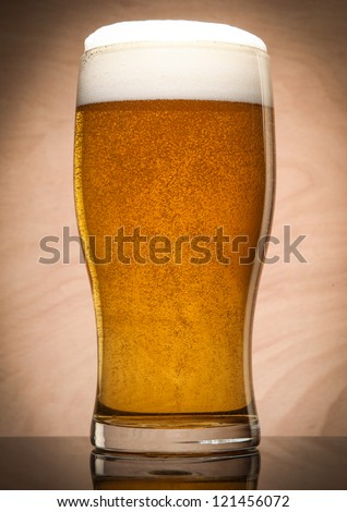 Glass with beer served on the table - stock photo