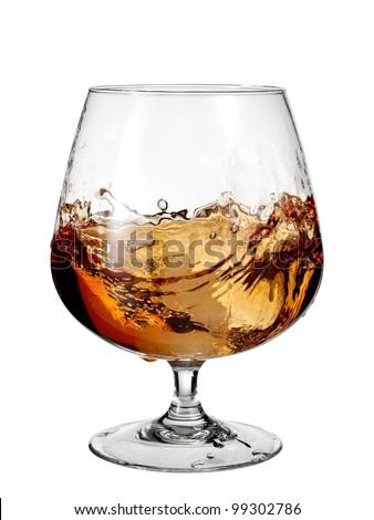 Glass with brandy plash - stock photo
