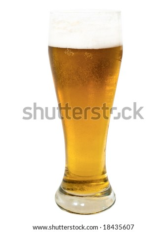 glass with golden beer on the white surface