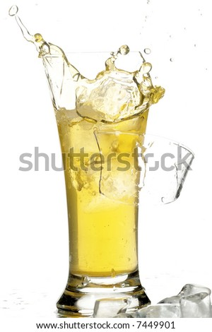 glass with juice and ice on the white background