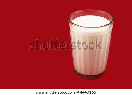 Glass with milk  on the red background