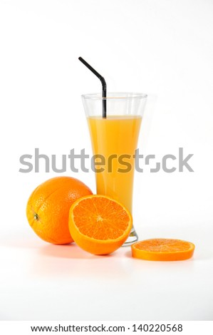 glass with orange juice, fruit piece and slice