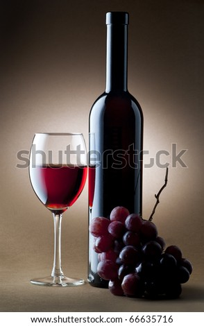glass with red wine and cluster