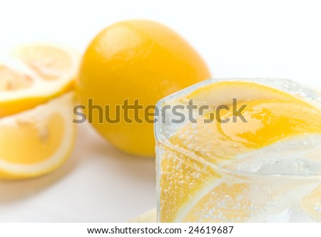 glass with soda water and lemon slices