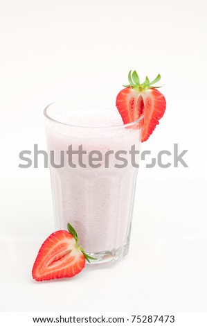 glass with strawberries milkshake