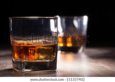 glass with whiskey - stock photo