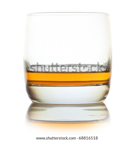 Glass with whiskey isolated over white background
