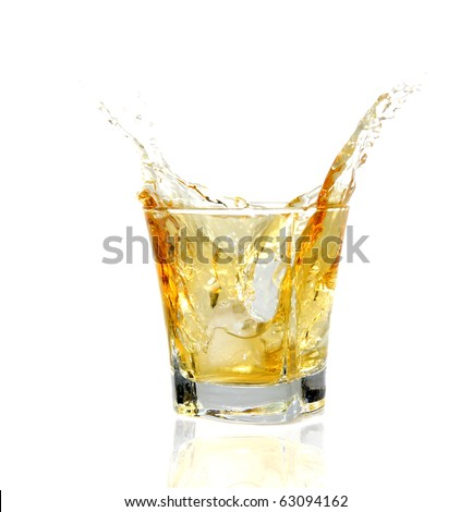 GLass with Whiskey splashing out - stock photo