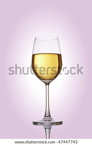 Glass with white wine on a rose background - stock photo