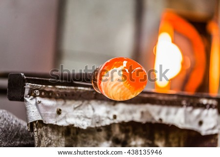 Glassblowing Spinning Piece and Furnace in Background