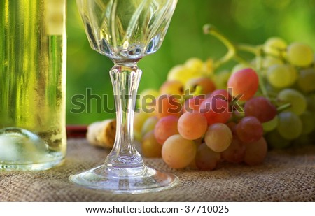 Glassd of wine and grappes. - stock photo