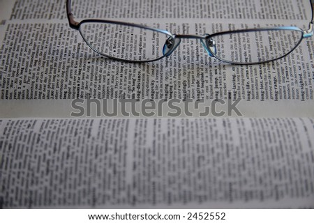 Glasses and a book - stock photo
