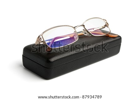 glasses and a leather case isolated on white background