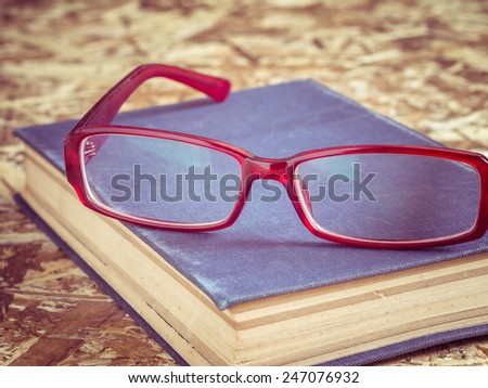 glasses and book with filter effect retro vintage style - stock photo