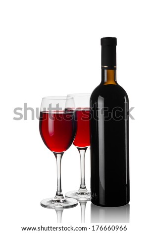 Glasses and bottles of red wine isolated  - stock photo