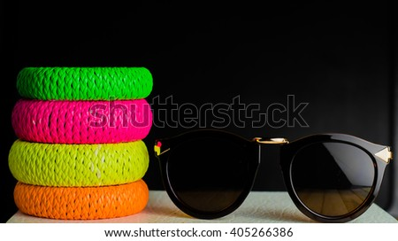 glasses and colored bracelets