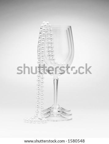 Glasses and pearls - stock photo