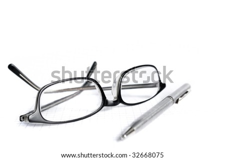 Glasses and pen isolated on white - stock photo