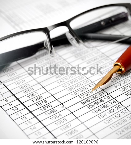 Glasses and pen on documents. - stock photo