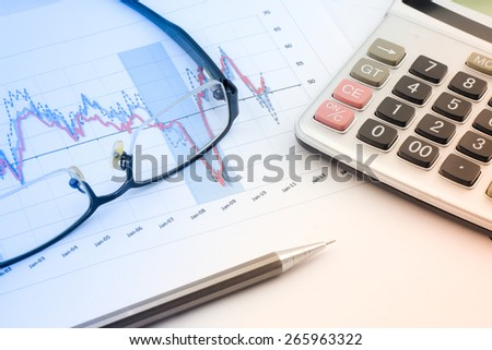 Glasses and Pencil:Analysis charts and graphs of sales -successful corporate business - stock photo