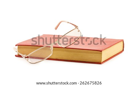 Glasses and red book isolated on white background - stock photo