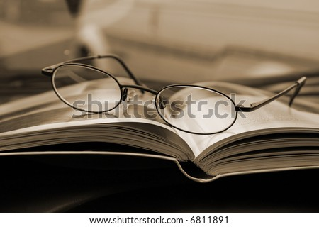 Glasses and the Magazine - Close Up