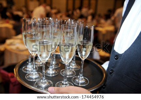 glasses being served on a party - stock photo