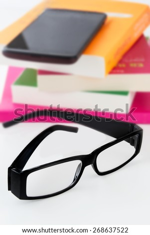 Glasses, books and mobile - stock photo