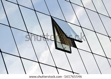Glasses building with open window. - stock photo