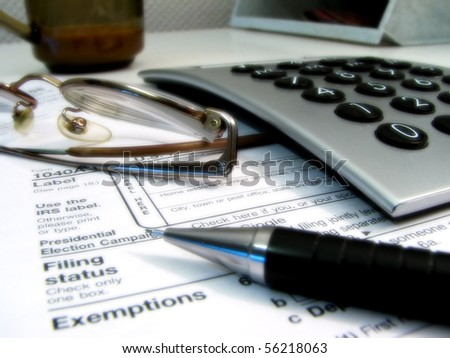 Glasses, calculator, pen and coffee cup - stock photo