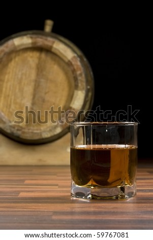 glasses from old whisky on a wooden table - stock photo