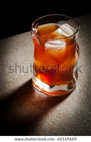glasses from whiskey on a wooden table - stock photo