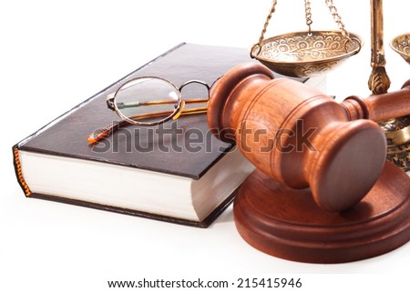 Glasses in a circular frame with a book and scales, gavel
