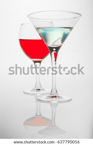 glasses in glamour blue red lighting in white