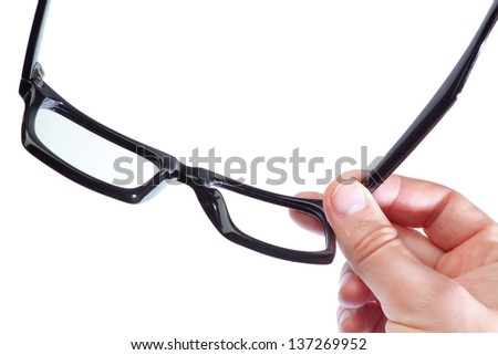 Glasses in the hand of a man on a white background. Close-up. - stock photo