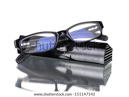 Glasses lies on cover of case - stock photo