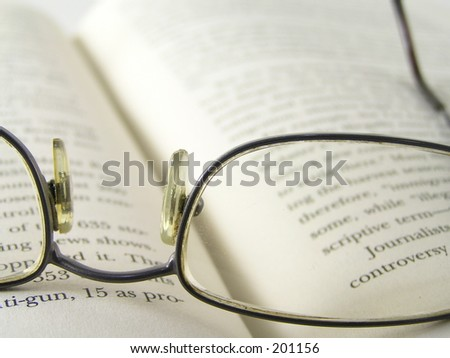 Glasses lying on an open book