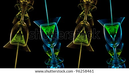 Glasses mix color on black background - stock photo