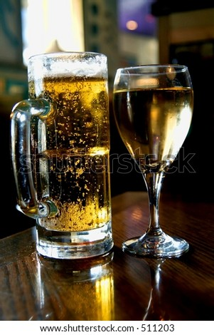 Glasses of beer abd wine on table - stock photo